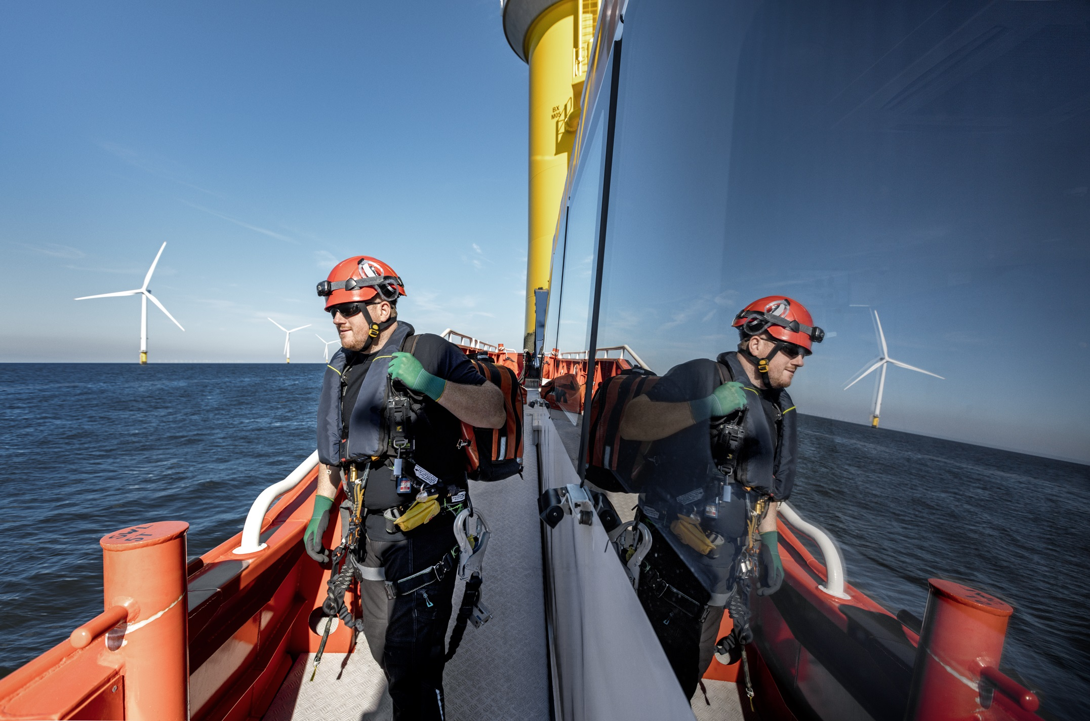 An operator works at Ørsted's Burbo Bank Extension offshore wind farm, in Northwest UK